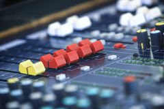 Audio mixing console in a recording studio Royalty Free Stock Image