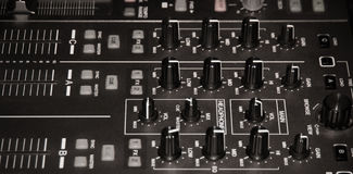 Audio mixing console. Sound mixing console lit by an incandescent lamp Royalty Free Stock Photos