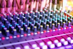Audio Mixing Console. Sound Music Mixer Equipment. DJ Audio Mixing Console. Sound Music Mixer in Dance Night Club Party. Selective Focus royalty free stock image