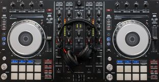 Audio mixing controller with professional headphones. DJ tools. Top view stock photography