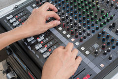 Audio musical mixer. Hand of the audio musical mixer Royalty Free Stock Image