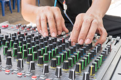 Audio musical mixer. Hand of the audio musical mixer Stock Images