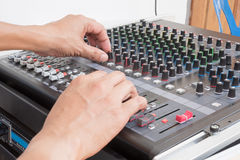 Audio musical mixer. Hand of the audio musical mixer Royalty Free Stock Images