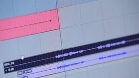 Audio- oder solide redigierende Software, die die Zeitachse durchläuft stock video