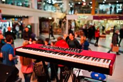 Audio piano on stage in a concert hall behing peoples.  stock image