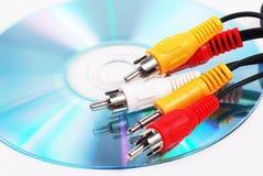 Audio plug. Five head Audio plug on CD Royalty Free Stock Image