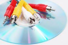 Audio plug. Five head Audio plug on CD Stock Photography
