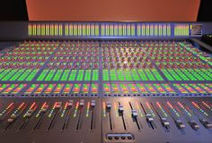 Audio post production mixing console. With lights on stock photography