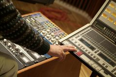 Audio producer. Man at work on a Audio Mixing Console Stock Photo