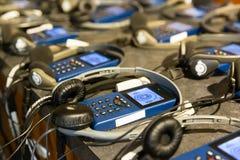 Audio przewdonik z hełmofonami Zdjęcie Royalty Free