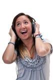 Audio que escucha alegre Fotografía de archivo libre de regalías