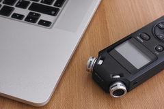 Audio recorder and laptop Royalty Free Stock Photo