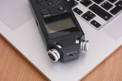 Audio recorder and laptop Stock Photos