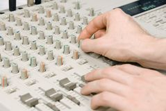 Audio recording. Hands of an audio engineer at work stock photo