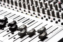 Audio Recording Equipment. Or soundboard background with many knobs and adjustments, board is a little dusty Royalty Free Stock Images