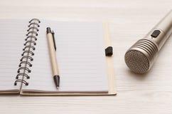 Karaoke singer. Microphone. Sound recording studio background. Song lyrics copy space. Audio recording studio desk table. Karaoke mock up. Microphone and blank royalty free stock photos
