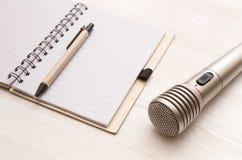 Karaoke singer. Microphone. Sound recording studio background. Song lyrics copy space. Audio recording studio desk table. Karaoke mock up. Microphone and blank stock photos