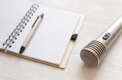 Karaoke singer. Microphone. Sound recording studio background. Song lyrics copy space. Audio recording studio desk table. Karaoke mock up. Microphone and blank royalty free stock photo