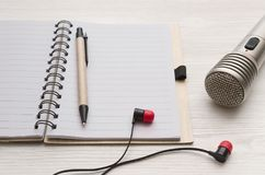 Karaoke singer. Microphone. Sound recording studio background. Song lyrics copy space. Audio recording studio desk table. Karaoke mock up. Microphone royalty free stock photography