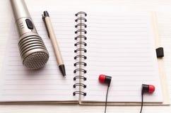 Karaoke singer. Microphone. Sound recording studio background. Song lyrics copy space. Audio recording studio desk table. Karaoke mock up. Microphone stock photography