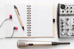 Karaoke singer. Microphone. Sound recording studio background. Song lyrics copy space. Audio recording studio desk table. Karaoke mock up. Song lyrics stock photos