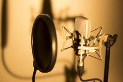 Audio recording vocal studio voice microphone. With anti shock mount and built in anti pop filter for singing and voiceover actors doing voiceovers stock photo