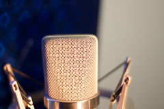 Audio recording vocal studio voice microphone. With anti shock mount and built in anti pop filter for singing and voiceover actors doing voiceovers stock images