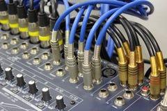 Audio signal on the mixer. Royalty Free Stock Photo