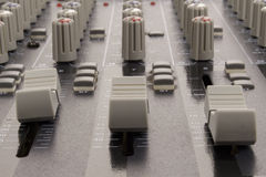 Audio sliders of a mixing console Stock Photos