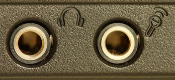 Audio sockets. On the side of a black laptop Royalty Free Stock Image