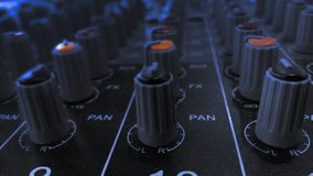 Audio sound equalizer equipment in concert night club party festival. Sound mixer with various knobs and sliders royalty free stock photo