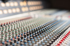 Audio sound mixer with buttons. Large music mixer desk in recording studio Stock Photos