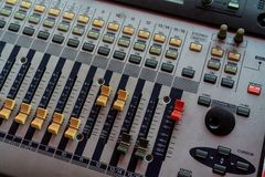 Audio sound mixer console. Sound mixing desk. Music mixer control panel in recording studio. Audio mixing console with faders. And adjusting knob. Sound stock image