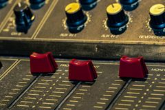 Audio sound mixer console. Sound mixing desk. Music mixer control panel in recording studio. Audio mixing console with faders. And adjusting knob. Sound royalty free stock images