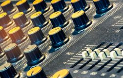 Audio sound mixer console. Sound mixing desk. Music mixer control panel in recording studio. Audio mixing console with faders. And adjusting knob. Sound royalty free stock photography