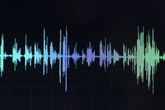 Audio sound wave studio editing. Computer program screen showings sounds on screen from vocal recording of voiceover stock image