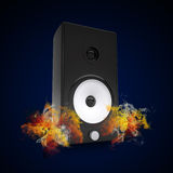 Audio speaker in the colored smoke Stock Photo
