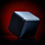 Audio speaker. On red background Stock Photos