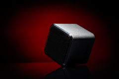 Audio speaker. On red background Royalty Free Stock Photo