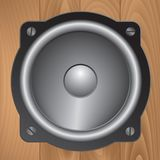 Audio speaker on wooden background Royalty Free Stock Image