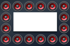 Audio speakers, subwoofers, wall of sound loudspeaker with red diffuser isolated on dark background Stock Image