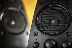 Audio speakers on yellow background Royalty Free Stock Photos
