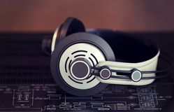 Audio Stereo Headphones on the top of Vintage Amplifier. Top View stock photos