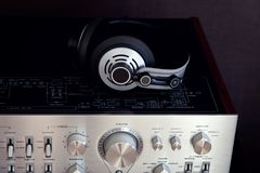 Audio Stereo Headphones on the top of Vintage Amplifier. Top View royalty free stock photo