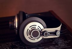 Audio Stereo Headphones on the top of Vintage Amplifier. Top View stock photo