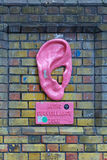Audio Surveillance Zone. LONDON, UNITED KINGDOM - NOVEMBER 24: Audio Surveillance Zone in East London on NOVEMBER 24, 2013. Big Pink Ear Art Installation by Royalty Free Stock Images