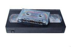 Audio tape cassette and VHS video tape cassette on white background. Isolated royalty free stock photo