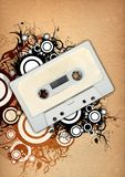 Audio tape & floral design elements. Retro audio tape on aged  paper with grunge and floral design elements,illustration Royalty Free Stock Photography