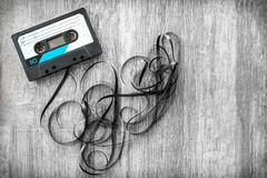Audio tape rolled out background wood vintage unroll compact cas Royalty Free Stock Photography