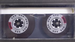 Audio Tape. Vintage Tape Recorder Plays Audio Cassette inserted therein stock video footage